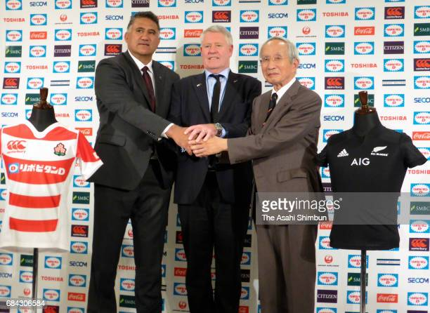 Japan national team head coach Jamie Joseph New Zealand Rugby CEO Steve Tew and Japan Rugby Football Union President Tadashi Okamura shake hands...