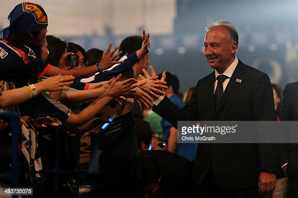 Japan national team manager Alberto Zaccheroni high fives fans during the World Cup send-off press conference for Japanese team on May 25, 2014 in...