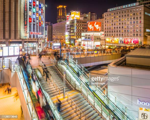 japan neon night shopping in busy city street osaka - elevated railway track stock pictures, royalty-free photos & images