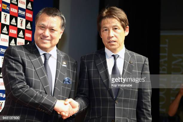Japan new head coach Akira Nishino and Japan Football Association President Kozo Tashima sakes hand a press conference at the JFA House on April 12...