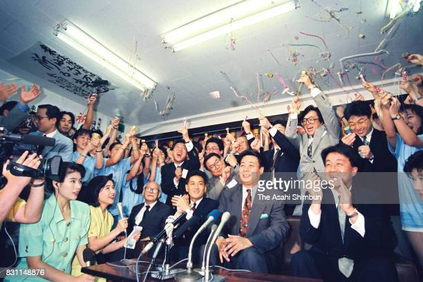 Japan New Party candidate Banri Kaieda is congratulated on his victory as the vote counting of the general election continues on July 18 1993 in...