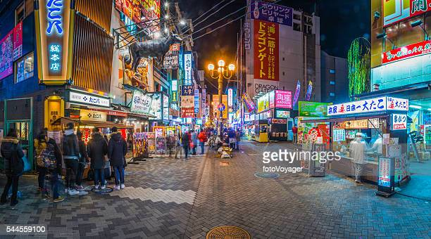 Japan nightlife crowds at colorful neon restaurants panorama Dotonbori Osaka