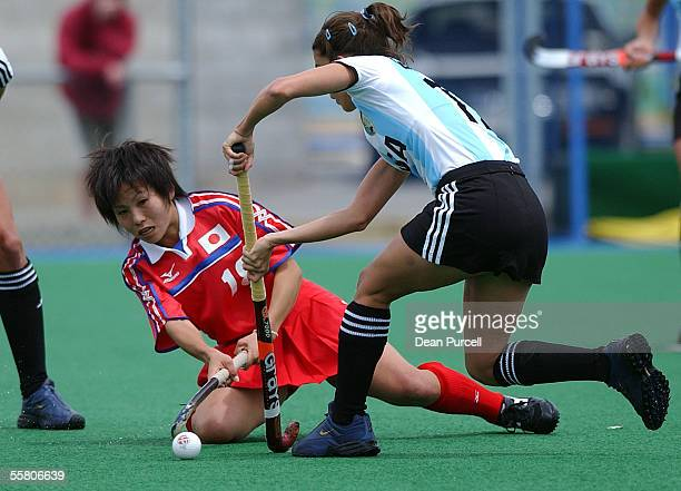 Japan No18 Tomomi Komori competes for the ball with Argentina's Mariana Gonzalez Oliva during the Hockey TriSeries match between Japan and Argentina...