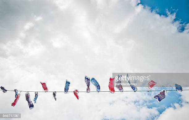 Japan, Okinawa, Children's day koi flags against clouds
