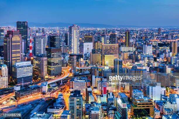 japan osaka. cityscape at sunset - marco brivio stock pictures, royalty-free photos & images