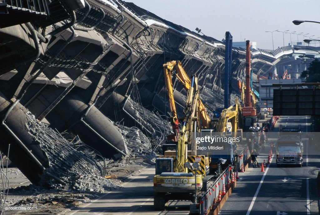 Japan, Osaka, Kobe, cranes by overpass destroyed during earthquake : News Photo