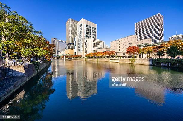 Japan, Osaka, Nakanoshima district, skyscrapers at the water