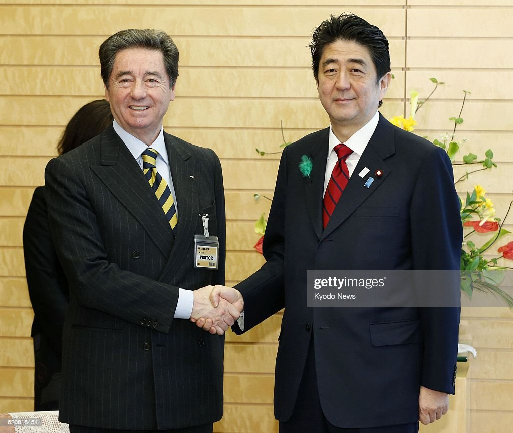 TOKYO, Japan - Ottavio Cinquanta (L), president of the International Skating Union, and Japanese Prime Minister Shinzo Abe shake hands at the prime minister's office in Tokyo on April 11, 2013.