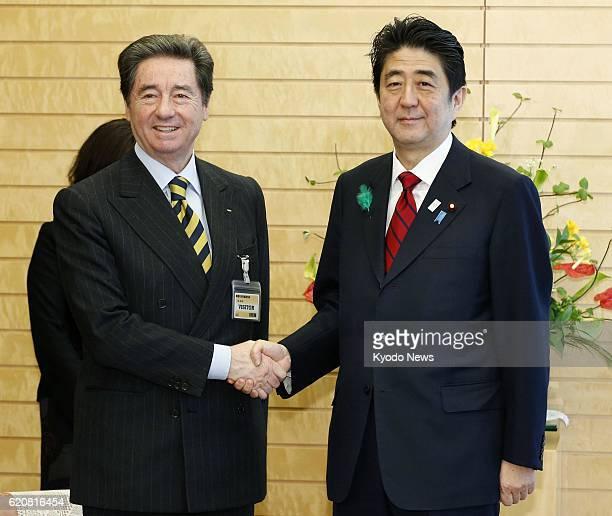 TOKYO Japan Ottavio Cinquanta president of the International Skating Union and Japanese Prime Minister Shinzo Abe shake hands at the prime minister's...