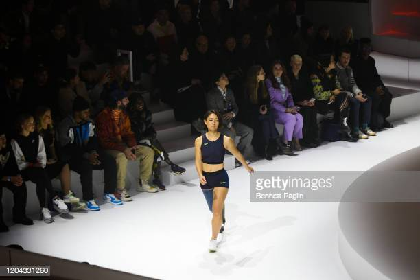 Japan Paralympic Track and Field athlete Maya Nakanishi walks the runway during the 2020 Tokyo Olympic collection fashion show at The Shed on...