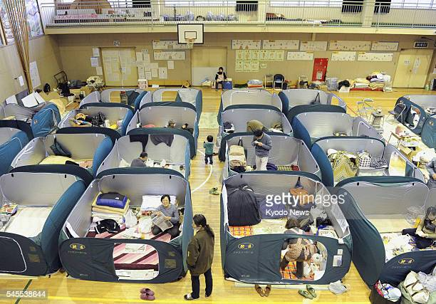 Japan - Partitions are set up to provide some privacy at an elementary school gymnasium used as an evacuation shelter in Kamaishi, Iwate Prefecture,...