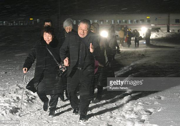 DAISEN Japan Passengers walk to buses in the snow in Daisen Akita Prefecture past 10 pm on March 2 after getting off a bullet train that derailed on...