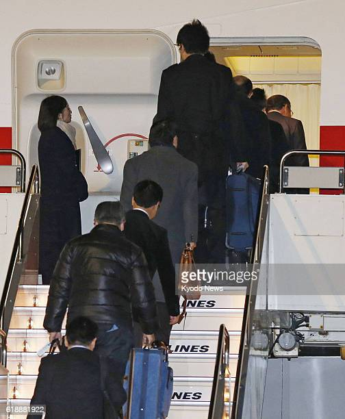 TOKYO Japan People board a Japanese government aircraft at Haneda airport in Tokyo on Jan 22 ahead of its departure for Algeria Tokyo dispatched the...
