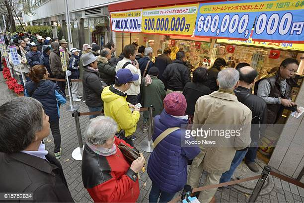 TOKYO Japan People line up at a lottery booth in Tokyo's Ginza district as sales of the yearend 'Jumbo' lottery which provides the chance to win up...