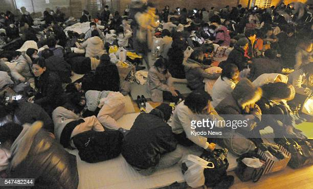 Japan - People take refuge in a shelter without electricity due to a power outage in Sendai, Miyagi Prefecture, after a powerful earthquake struck...