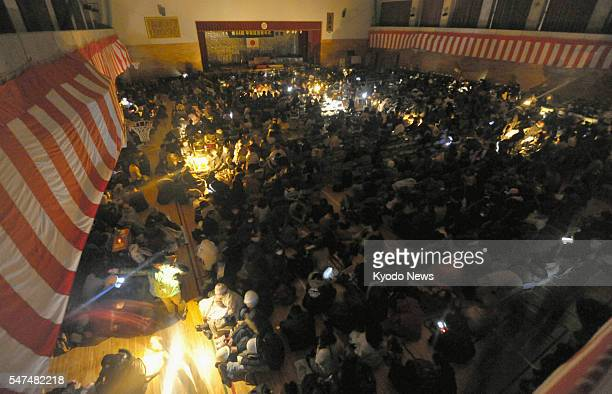 Japan - People take shelter in Sendai, Miyagi Prefecture, northeastern Japan, on March 11 after evacuating due to a powerful earthquake that jolted...