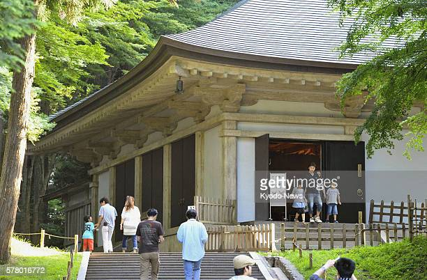 HIRAIZUMI Japan People visit Konjikido Sheath Hall of Chusonji a Buddhist temple in the Hiraizumi area on June 25 which the UN Educational Scientific...