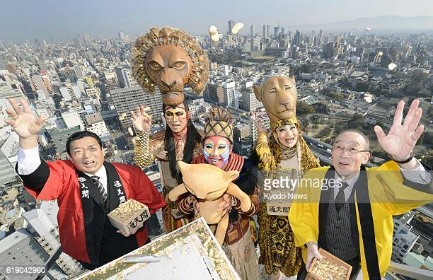 OSAKA Japan Performers from Shiki Theatre Co's musical The Lion King participate in an annual beanthrowing event atop Tsutenkaku tower in Osaka's...