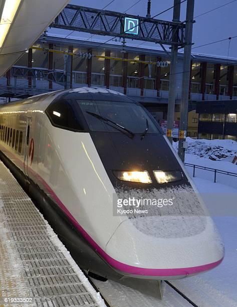 AKITA Japan Photo shows a bullet train at Akita station in Akita Prefecture past 6 am on March 4 2013 The Akita Shinkansen Line resumed operations...