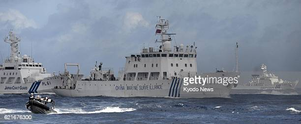 ISHIGAKI Japan Photo shows a Chinese maritime surveillance vessel surrounded by Japan Coast Guard patrol ships in Japanese territorial waters near...