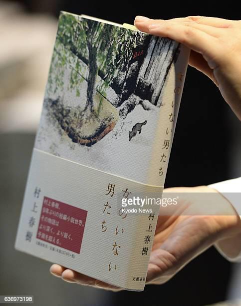 TOKYO Japan Photo shows a copy of Japanese novelist Haruki Murakami's latest work a collection of short stories entitled 'Onna no Inai Otokotachi'...