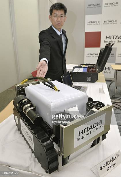 Japan - Photo shows a robot that can move through radioactive water to perform research related to the removal of melted nuclear fuel developed by...