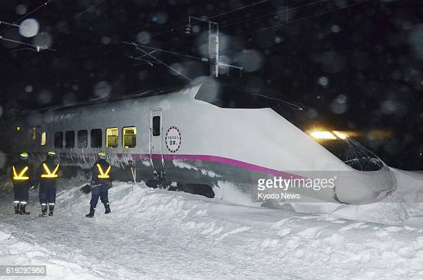 AKITA Japan Photo shows the front car of a bullet train that derailed on the Akita Shinkansen Line in Daisen Akita Prefecture on March 2 2013 The...