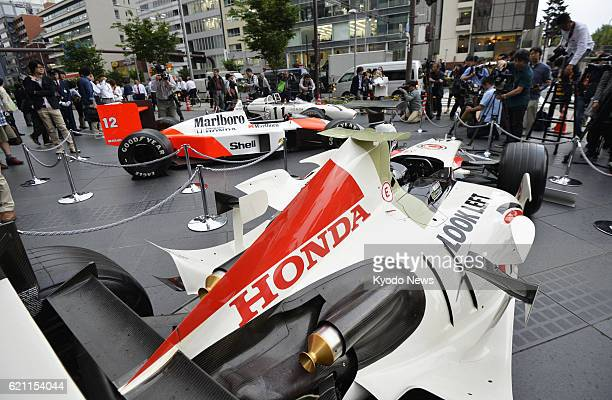 TOKYO Japan Photo shows vehicles used in past Formula One motor races on display in front of the Honda Motor Co head office in Tokyo on May 16 2013...