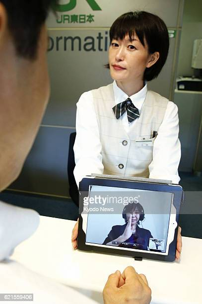 TOKYO Japan Photo taken at Tokyo's Shinagawa Station on June 17 shows East Japan Railway Co testing a sign language interpretation service using a...