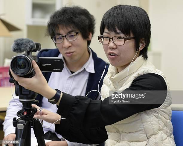 Japan - Photo taken Feb. 8, 2014 shows Keiko Takahashi and Kai Sato practicing interviewing at Fukushima University in Fukushima, Fukushima...