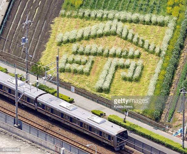 AMAGASAKI Japan Photo taken from a Kyodo News helicopter on April 24 shows the kanji for ''life'' formed by flowers in a field near the site of a...
