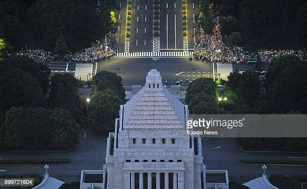 TOKYO Japan Photo taken from a Kyodo News helicopter on July 29 shows antinuclear protesters in front of the Diet building in Tokyo People lit...
