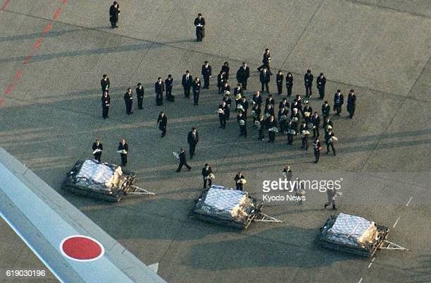 TOKYO Japan Photo taken from a Kyodo News helicopter shows officials of the Japanese government and JGC Corp placing flowers on the coffins of...