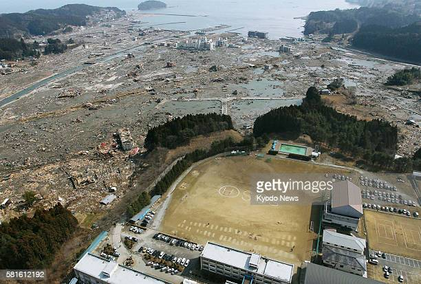 MINAMISANRIKU Japan Photo taken from a Kyodo News helicopter shows the letters ''SOS'' on an athletic field at Shizugawa High School as people await...