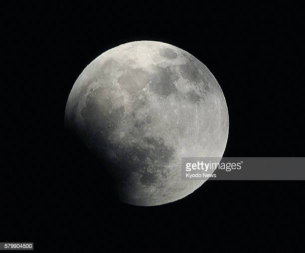 50 pm on Dec 10 shows the moon in an early stage of a total lunar eclipse The phenomenon is observed when the Earth passes between the sun and moon...