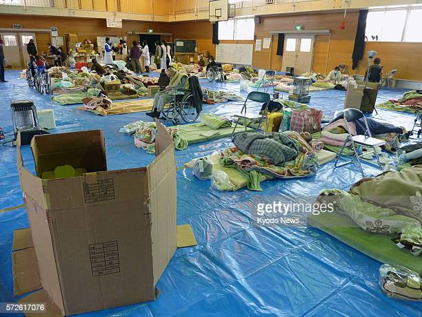 Japan - Photo taken on March 21 shows an evacuation center for quake-hit people who need assistance in their daily activities. A portable toilet is...