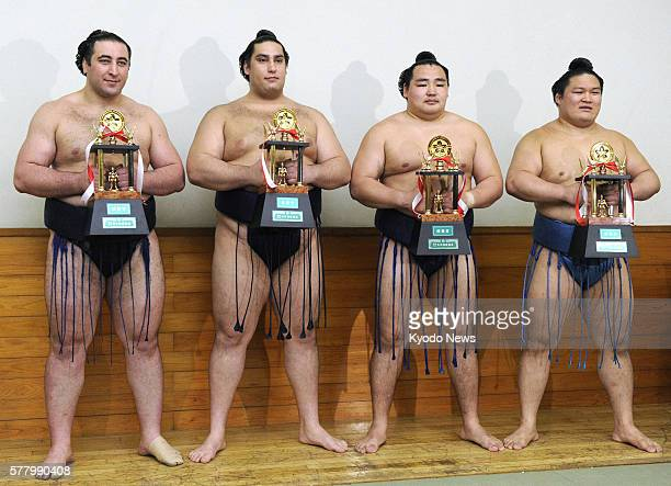 TOKYO Japan Photo taken on May 2011 shows sumo wrestlers holding their trophies at Ryogoku Kokugikan in Tokyo after being awarded special prizes From...