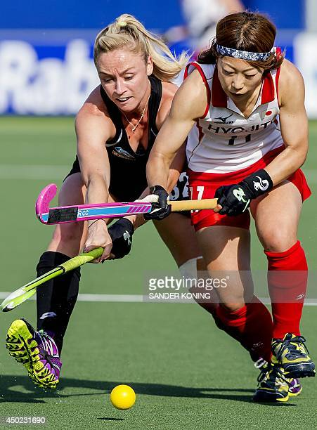 Japan player Akane Shibata vies for the ball with New Zealand player Stacey Michelsen during the Field Hockey World Cup Women's tournament match...