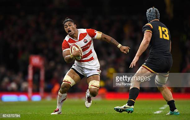 Japan player Amanaki Lelei Mafi runs at Jonathan Davies during the International match between Wales and Japan at Principality Stadium on November 19...