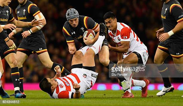 Japan player Satoshi Nakatani is knocked over by Jonathan Davies during the International match between Wales and Japan at Principality Stadium on...