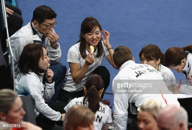 Japan players are seen during a break in play during the Women's Round Robin Session 10 on day eleven of the PyeongChang 2018 Winter Olympic Games at...