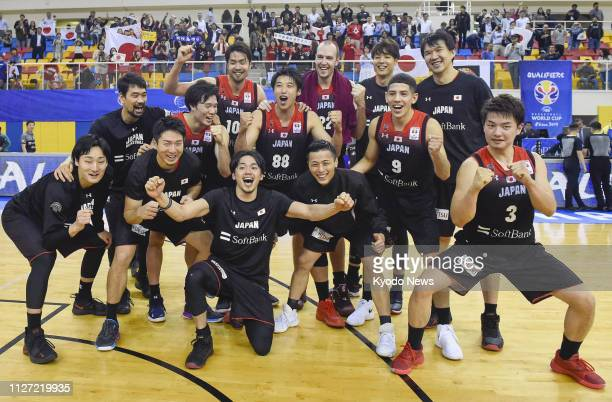 Japan players celebrate after beating Qatar 9648 in an Asian qualifier match in Doha on Feb 24 and booking a ticket to the basketball World Cup in...
