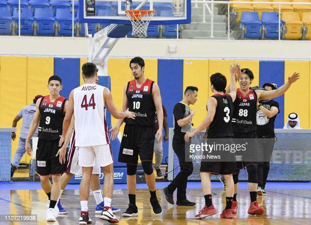 Japan players celebrate after beating Qatar 9648 in an Asian qualifier match in Doha on Feb 24 booking a ticket to the basketball World Cup in China...