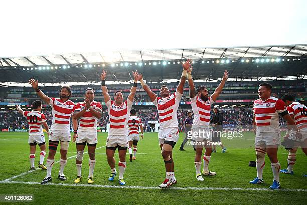 Japan players celebrate after the 2015 Rugby World Cup Pool B match between Samoa and Japan at Stadium mk on October 3 2015 in Milton Keynes United...