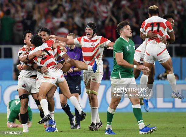 Japan players celebrate after their 1912 victory in the Rugby World Cup 2019 Group A game between Japan and Ireland at Shizuoka Stadium Ecopa on...