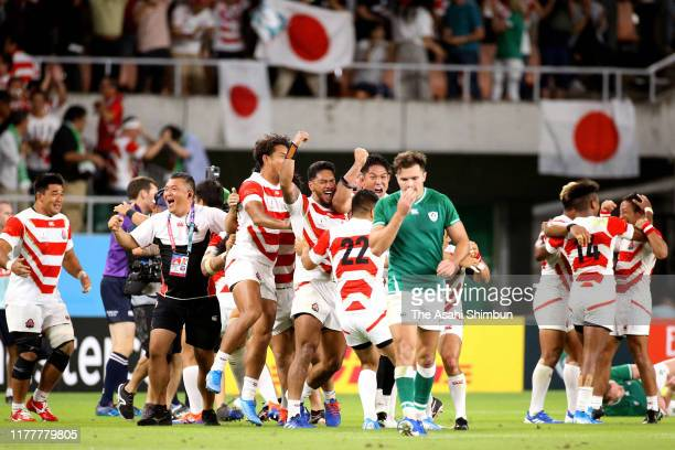 Japan players celebrate after their victory in the Rugby World Cup 2019 Group A game between Japan and Ireland at Shizuoka Stadium Ecopa on September...