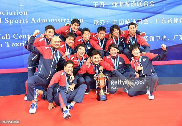 Japan players celebrate after winning the final match against China during the Asian Water Polo Championship at Century Lotus Sports Center on...