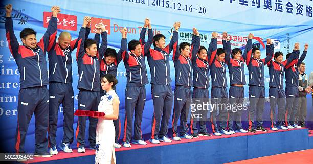 Japan players celebrate on the podium after winning the final match against China during the Asian Water Polo Championship at Century Lotus Sports...