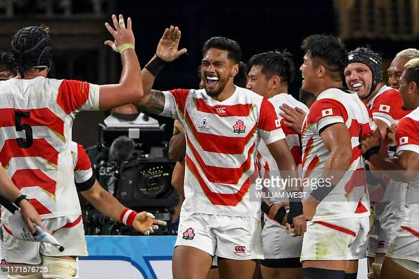Japan players celebrate scoring a try during the Japan 2019 Rugby World Cup Pool A match between Japan and Ireland at the Shizuoka Stadium Ecopa in...