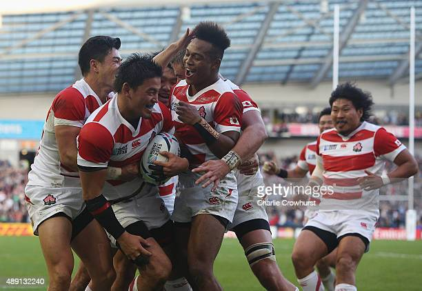 Japan players celebrate the try of Ayumu Goromaru of Japan during the 2015 Rugby World Cup Pool B match between South Africa and Japan at the...